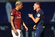 AS Roma's French midfielder Jordan Veretout discusses with AC Milan's French defender Theo Hernandez during the Serie A match at Giuseppe Meazza, Milan. Picture date: 28th June 2020. Picture credit should read: Jonathan Moscrop/Sportimage
