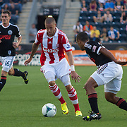 Stoke City F.C. Midfielder MICHAEL KIGHTLY (21) dribbles the ball towards the net in the first half a MLS regular season international friendly match against the Philadelphia Union Tuesday, July. 30, 2013 at PPL Park in Chester PA.