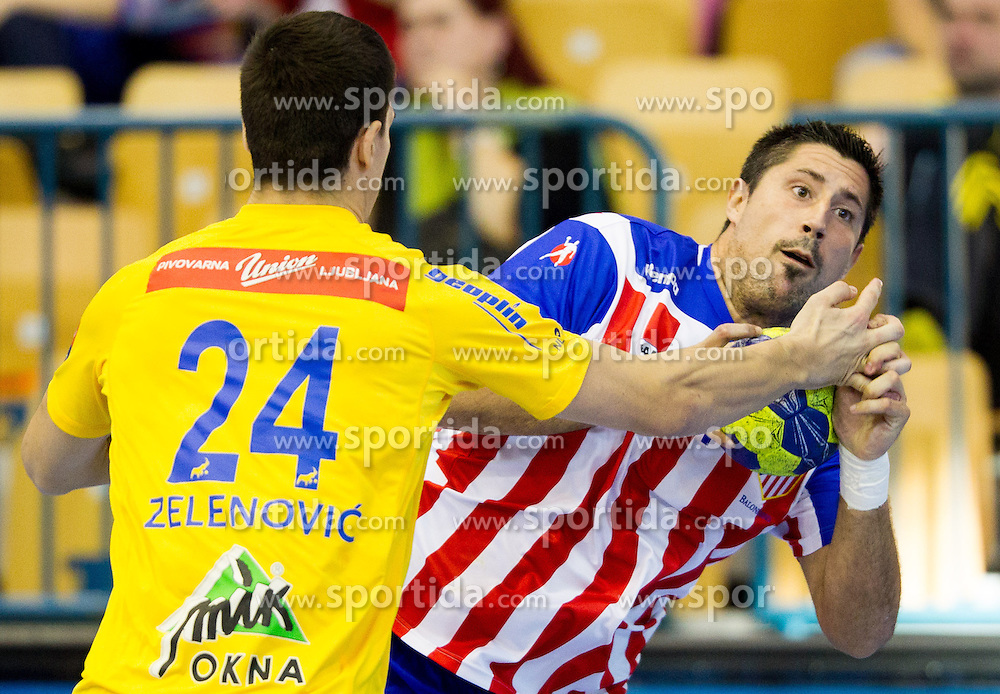 Nemanja Zelenovic of Celje vs Eduard Fernandez Roura of Atletico Madrid during handball match between RK Celje Pivovarna Lasko and BM Atletico Madrid in 2nd Round of Group B of EHF Champions League 2012/13 on October 6, 2012 in Arena Zlatorog, Celje, Slovenia. (Photo By Vid Ponikvar / Sportida)
