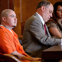 030514       Cable Hoover<br /> <br /> Natanael Escarcega sits with his legal team after pleading guilty to manslaughter Wednesday at district court in Gallup.