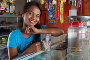 Jula Eha runs a small shop from the front of her house in a quiet residential area near the town of Bogor, Indonesia.<br /> <br /> Her shop had mixed success at first and she used to become demotivated, but after subscribing to Usaha Wanita she regained her motivation and started to think of more creative ways to make her business a success. <br /> <br /> As a result her profits have increased and she is now saving money in an education fund for her children. <br /> <br /> She has also been able to follow Usaha Wanita's advice on savings and investments and she has joined a savings scheme and purchases new fridges and display cabinets for her store.