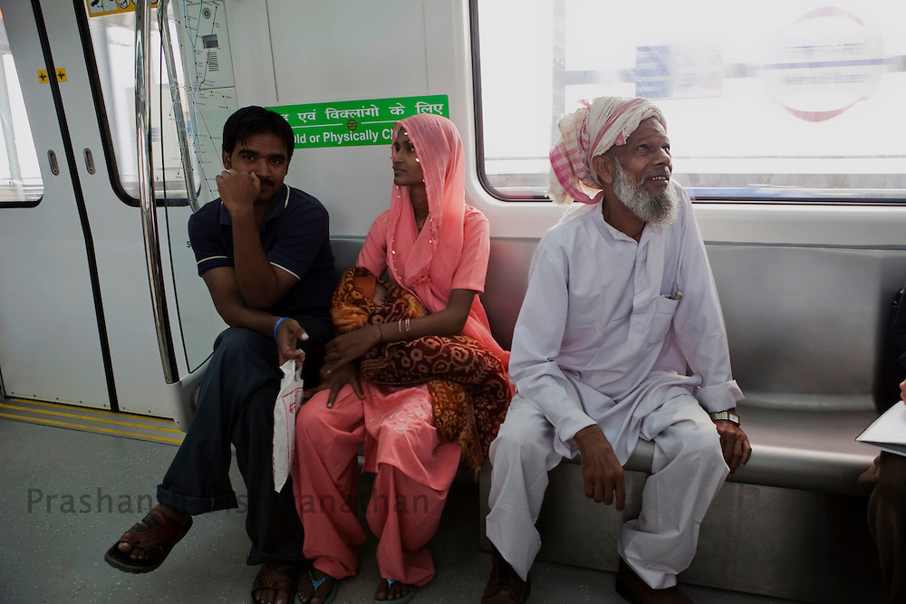 "Raheez Ahmad, 67 travels inside a metro train for the first time using the ""Yellow Line"" route of the Delhi Metro network in New Delhi, India, on Friday, October 22, 2010. Photographer: Prashanth Vishwanathan/HELSINGIN SANOMAT"