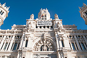 Refugees Welcome banner draped across the facade of the Palacio de Cibeles, City Hall, Madrid, Spain
