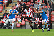 Sam Magri, Amari Morgan-Smith and Richard Orlu during the Vanarama National League match between Cheltenham Town and Dover Athletic at Whaddon Road, Cheltenham, England on 12 September 2015. Photo by Antony Thompson.