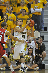 Jan 23, 2010; Columbia, MO, USA; Missouri Tigers forward Justin Safford (23) looks to pass as Nebraska Cornhuskers guard Ryan Anderson (44) provides defense in the first half at Mizzou Arena in Columbia, MO. Missouri won 70-53. Mandatory Credit: Denny Medley-US PRESSWIRE