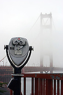 A view of the Golden Gate Bridge hidden in the fog.