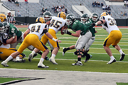 12 November 2011:  Camerson Blossom evades Grant Putnam and gets a block from Matt Siegert on Gary Miller during an NCAA division 3 football game between the Augustana Vikings and the Illinois Wesleyan Titans in Tucci Stadium on Wilder Field, Bloomington IL