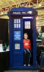 10 January 2015. New Orleans, Louisiana. <br /> Ben and the Dr Who Tardis at the Wizard World New Orleans Comic Con 2015 at the Morial Convention Center. A Stormtrooper arrests Princess Leia.<br /> Photo; Charlie Varley/varleypix.com