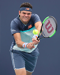 March 24, 2019 - Miami Gardens, Florida, United States Of America - MIAMI GARDENS, FLORIDA - MARCH 24:  Milos Raonic on Day 7 of the Miami Open Presented by Itau at Hard Rock Stadium on March 24, 2019 in Miami Gardens, Florida..People: Milos Raonic. (Credit Image: © SMG via ZUMA Wire)