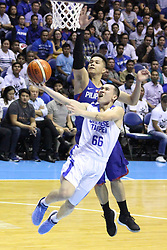 November 27, 2017 - Quezon City, NCR, Philippines - Roger Ray Pogoy (16) of the Philippines tries to block a lay-up attempt by Kai-Yan Lee (66) of Chinese Taipei during their FIBA World Cup Qualifying Match..Gilas Pilipinas defeated the visiting Chinese Taipei team 90-83 to complete a sweep of their first two assignments in the FIBA 2019 World Cup qualifiers. (Credit Image: © Dennis Jerome S. Acosta/Pacific Press via ZUMA Wire)