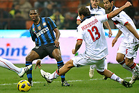 Samuel Eto'o (Inter) e Daniele Portanova (Bologna)<br /> Inter Bologna - Campionato di Seire A Tim 2010-2011<br /> Stadio Giuseppe Meazza, San Siro, Milano, 15/01/2011<br /> © Giorgio Perottino / Insidefoto