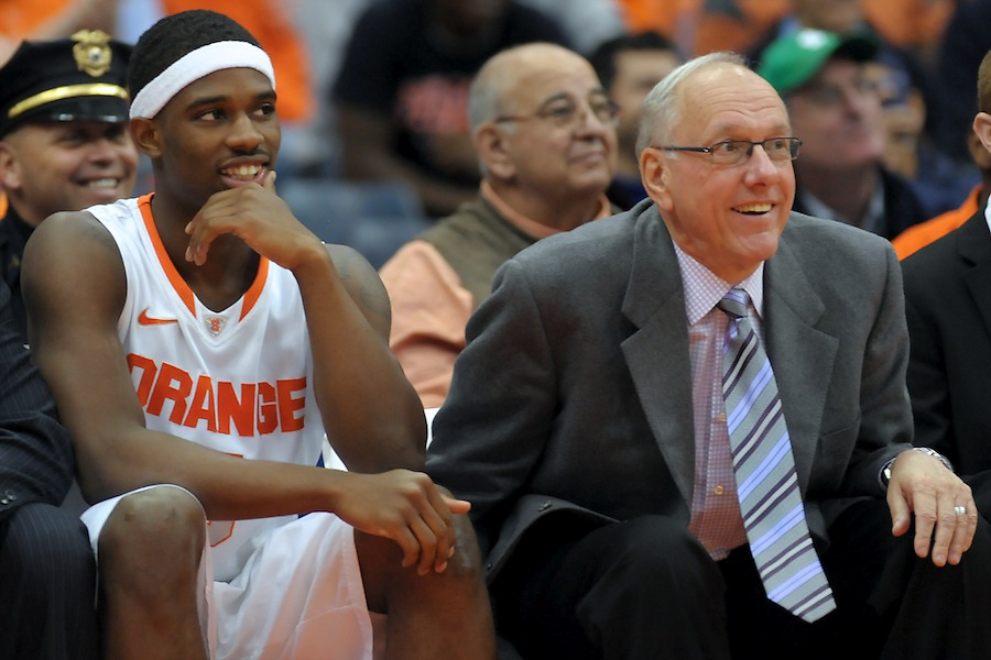 Syracuse Orange head coach JIM BOEHEIM and Syracuse Orange forward C.J. FAIR (5) react to a play by the third string against the Colgate Raiders during the second half at the Carrier Dome in Syracuse, New York. Number 6 ranked Syracuse defeated Colgate 87-51 to stay undefeated.