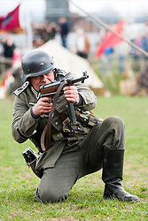 Reeactor portraying Stabsfelwebel from Infantry Regiment Grossdeutschland using a blank firing MP40 Sub Machine Gun.21 April  2013.Image © Paul David Drabble