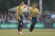 Hampshire all-rounder Ryan McLaren and Hampshire all-rounder Liam Dawson celebrate the wicket of Paul Stirling during the NatWest T20 Blast South Group match between Middlesex County Cricket Club and Hampshire County Cricket Club at Uxbridge Cricket Ground, Uxbridge, United Kingdom on 27 May 2016. Photo by David Vokes.