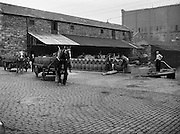 20/08/1958<br /> 08/20/1958<br /> 20 August 1958<br /> Transport at Guinness Brewery, St James's Gate, Dublin. Horse and Dray and barges at James St. Harbour. Richardsons owned transport for Guinness, CIE Owned harbour, storage and barges, transporting guinness to the midlands and turf back to Dublin