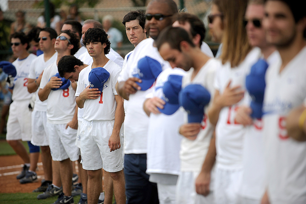 """AUGUST 19, 2009 BOCA RATON FLORIDA- Joe Jonas, of the Jonas Brothers, listens to the national anthem before the start of their  game against the Marquis Flyers. The Jonas Brothers and their team, the """"Road Dogs"""" took part in the softball game which was being held by Marquis Jet at the Saint Andrews School in Boca Raton, Fla. Marquis Jet has held 9 other softball games around the country as their company team the """"Marquis Flyers"""" competes in for fun games against various teams. PHOTO BY JOSH RITCHIE"""