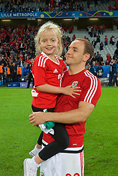 LILLE, FRANCE - Friday, July 1, 2016: Wales' David Vaughan and his daughter after the 3-1 victory over Belgium during the UEFA Euro 2016 Championship Quarter-Final match at the Stade Pierre Mauroy. (Pic by David Rawcliffe/Propaganda)