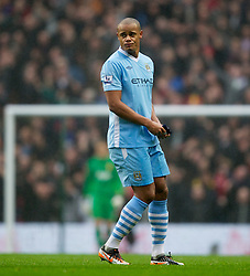 MANCHESTER, ENGLAND - Sunday, January 8, 2012: Manchester City's captain Vincent Kompany looks dejected as he is sent off with a red card against Manchester United during the FA Cup 3rd Round match at the City of Manchester Stadium. (Pic by Vegard Grott/Propaganda)