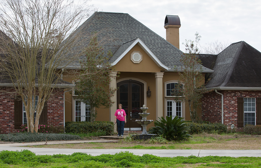 Carla Alleman in front of her 'dream' home in Bayou Corne. She and her husband bought their home and two adjoining lots where their sons built homes. She said finding a comparable situation in the area is not possible and is devastated by the sinkhole. She decided to stop going to most of the meetings and let her lawyers deal with Texas Brine becuase after six months of dealing with little but the sinkhole she realizes it is stressing out her grandchildren and she is missing precious moments in the lives.