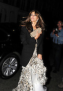 23.JUNE.2011. LONDON<br /> <br /> LIZ HURLEY AND SHANE WARNE ARRVING BACK AT HOME AT LIZ'S HOUSE AT 1.30AM AFTER ATTENDING ELTON JOHN'S BLACK & WHITE TIARA BALL IN WINDSOR.<br /> <br /> BYLINE: EDBIMAGEARCHIVE.COM<br /> <br /> *THIS IMAGE IS STRICTLY FOR UK NEWSPAPERS AND MAGAZINES ONLY*<br /> *FOR WORLD WIDE SALES AND WEB USE PLEASE CONTACT EDBIMAGEARCHIVE - 0208 954 5968*