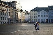 Two women walk through a public square in late day winter light off the Strøget in Copenhagen, Denmark. ©Brett Wilhelm