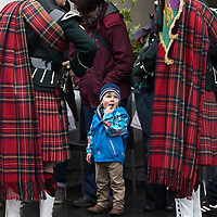 Remembrance Day Service, Perth…13.11.16<br />2 year old Euan Macaulay from Edinburgh watches Alan McDougall (left) and David Robertson of the Pipes and Drums of 7 Scots Royal Regiment of Scotland outside St John's Kirk in Perth for the Remembrance Day Service.<br />Picture by Graeme Hart.<br />Copyright Perthshire Picture Agency<br />Tel: 01738 623350  Mobile: 07990 594431