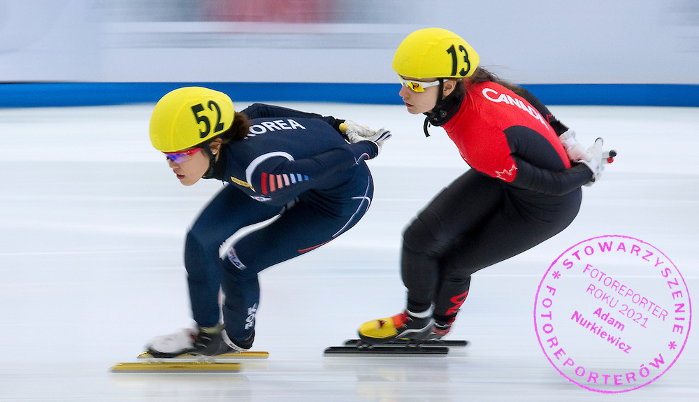 (L) Kim Alang of South Korea and (R) Geneve Belanger of Canada compete in the Women's 1000 Meters on day three of the 2013 ISU Short Track Speed Skating Junior World Championships at Torwar Ice Hall on February 24, 2013 in Warsaw, Poland...Poland, Warsaw, February 24, 2013...Picture also available in RAW (NEF) or TIFF format on special request...For editorial use only. Any commercial or promotional use requires permission...Photo by © Adam Nurkiewicz / Mediasport