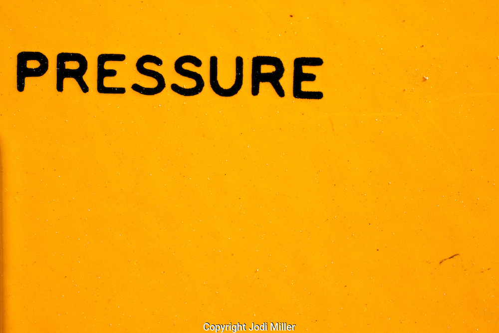 The word Pressure on a yellow background.