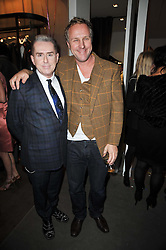 Left to right, HOLLY JOHNSON and SIMON MILLS at the launch party of 'Songs For Sorrow' hosted by Alber Elbaz and Mika held at Lanvin, 32 Savile Row, London on 11th November 2009.