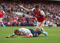 Football - 2019 / 2020 Premier League - Arsenal vs. Tottenham Hotspur<br /> <br /> Harry Kane (Tottenham FC) is adjudged to have dived after feeling the slightest touch from Sokratis Papastathopoulos who raises his arms (Arsenal FC) at The Emirates.<br /> <br /> COLORSPORT/DANIEL BEARHAM