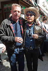 © Licensed to London News Pictures. 06/07/2014. London, England. Suggs of Madness and Adam Ant (Adam & the Ants) at the event. Celebrities attend the 65th Anniversary Celebrations of Bar Italia in Frith Street, Soho, London, in aid of Great Ormond Street Hospital. Photo credit: Bettina Strenske/LNP