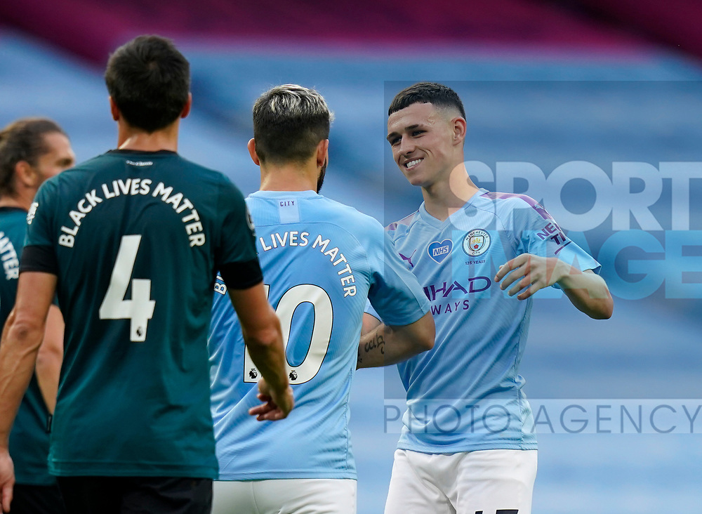 Phil Foden of Manchester City celebrates scoring the first goal with Sergio Aguero of Manchester Cityduring the Premier League match at the Etihad Stadium, Manchester. Picture date: 22nd February 2020. Picture credit should read: Andrew Yates/Sportimage