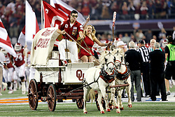 The Oklahoma Sooners wagon leads the team on to field the during the 77th AT&T Cotton Bowl Classic between the Texas A&M University Aggies and the Oklahoma University Sooners at Cowboys Stadium in Arlington, Texas. Texas A&M wins the 77th AT&T Cotton Bowl Classic against Oklahoma, 41-13.