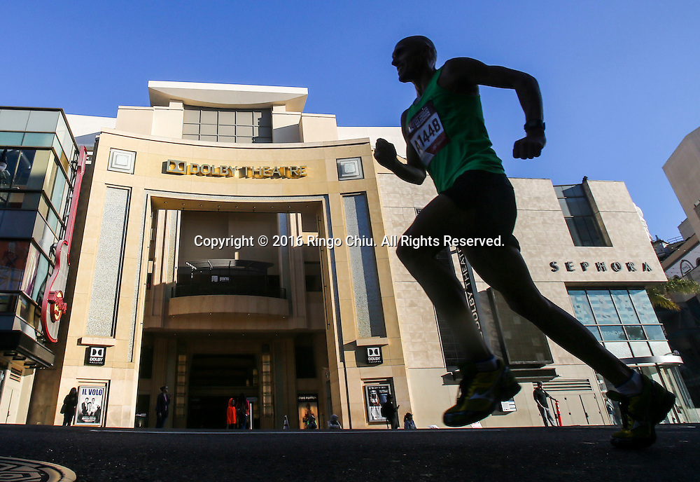 A runner makes his way along Hollywood Boulevard during the 31st Los Angeles Marathon in Los Angeles, Sunday, Feb. 14, 2016. The 26.2-mile marathon started at Dodger Stadium and finished at Santa Monica.  (Photo by Ringo Chiu/PHOTOFORMULA.com)<br /> <br /> Usage Notes: This content is intended for editorial use only. For other uses, additional clearances may be required.