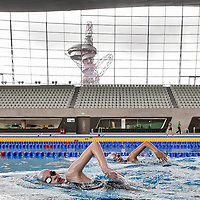 25/02/2014.LONDON UK. <br /> Kiran Vanderberg and Laura Atkinson get a chance to be one of the first to swim in the Olympic Swimming Pool at the London Aquatic Centre, as the former Olympic venue prepares to open its doors to the public this weekend.<br /> Photo credit : &copy;Andrew Baker