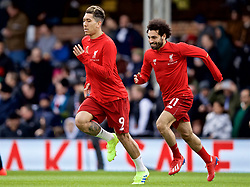 LONDON, ENGLAND - Sunday, March 17, 2019: Liverpool's Roberto Firmino (L) and Mohamed Salah (R) during the pre-match warm-up before during the FA Premier League match between Fulham FC and Liverpool FC at Craven Cottage. (Pic by David Rawcliffe/Propaganda)