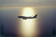 Airplane in light of the setting sun
