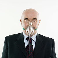 senior man portrait studio wearing oxygen mask