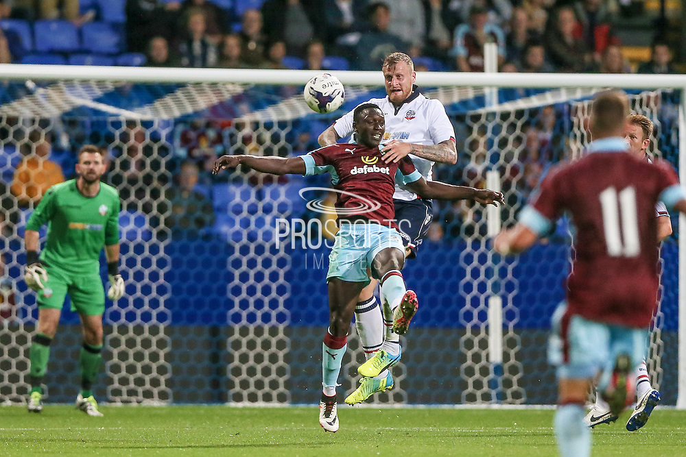 David Wheater (Bolton Wanderers) and Dan Agyei (Burnley) go for the header during the Pre-Season Friendly match between Bolton Wanderers and Burnley at the Macron Stadium, Bolton, England on 26 July 2016. Photo by Mark P Doherty.