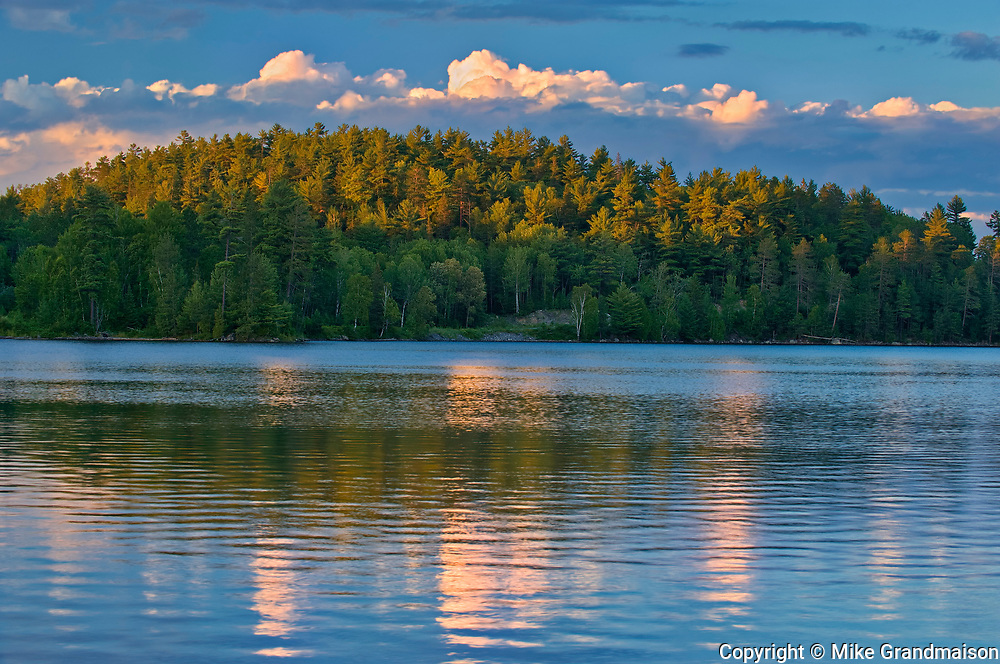 Clouds reflected in Snake Island Lake at sunset.  The White Bear Forest Conservation Reserve<br />