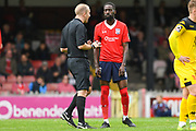 Adriano Moke of York City (6) gets a telling off from referee Adam Williamson during the Vanarama National League match between York City and Kidderminster Harriers at Bootham Crescent, York, England on 15 September 2018.