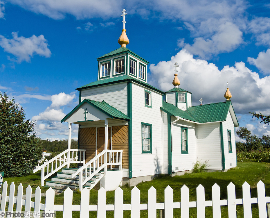"The Russian Orthodox Church in the town of Ninilchik was redesigned and constructed in 1901 in Alaska, USA. Notice that the Russian Orthodox Cross has two extra arms: the top arm represents the inscribed acronyms [ INRI in Latin,  in Greek, and a Hebrew version, meaning ""Jesus the Nazarene, King of the Jews"" ], and the angled bottom arm is his footrest. Russian Orthodox religion was born in Kiev in the ""land of the Rus"" in 988 AD as a branch of Eastern Orthodox Christianity. After Russian discovery of Alaska and the Aleutian Islands in 1741, Russian fur traders taught Christianity to Alaskan Natives. The first eight Russian Orthodox missionaries came to Kodiak Island, Alaska (Russian America) in 1794. The religion spread amongst Alaskans, and the monks mission was made a diocese of the Russian Orthodox Church a few years after the United States purchased Alaska from Russia in 1867. Ninilchik is on the Sterling Highway on the west side of the Kenai Peninsula on the coast of Cook Inlet, 186 miles by road from Anchorage and 38 miles from Homer. The Alaska Native Claims Settlement Act recognized Ninilchik as an Alaska Native village. Ninilchik hosts the annual Kenai Peninsula State Fair."