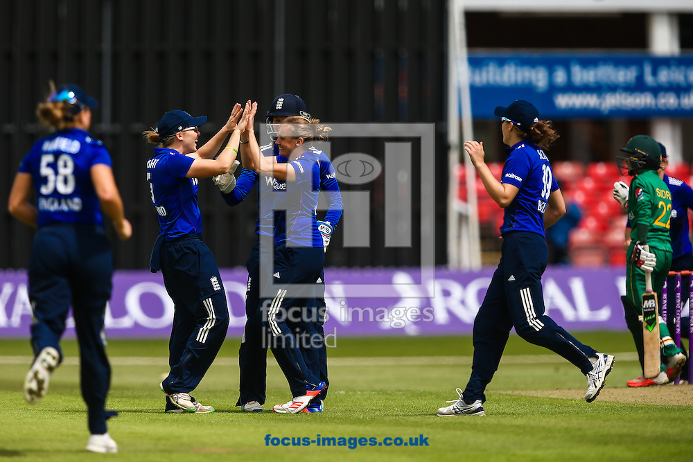 England players celebrate the dismissal of Sidra Nawaz (right) during the Royal London One Day Series match at Fischer County Ground, Leicester<br /> Picture by Andy Kearns/Focus Images Ltd 0781 864 4264<br /> 21/06/2016