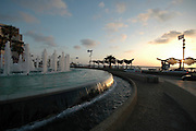 Water fountain, at sun set, on the beach front Tel Aviv, Israel