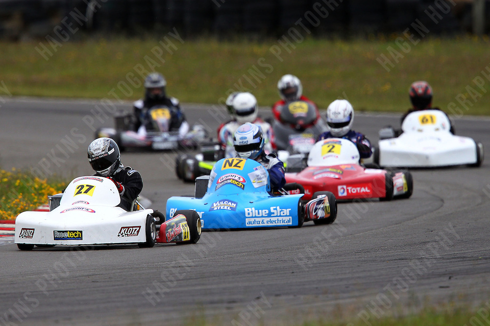Andrew Hoare, 27, Mason Armstrong, 63, Gareth Playle, NZ, Lochlan Miller, 2, and Derek Lawrence, 61, race in the Rotax Light class during the 2012 Superkart National Champs and Grand Prix at Manfeild in Feilding, New Zealand on Saturday, 7 January 2011. Credit: Hagen Hopkins.