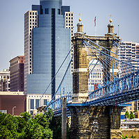 Photo of Cincinnati Scripps Center building and John A. Roebling bridge in downtown Cincinnati Ohio. Photo is vertical, high resolution and was taken in July 2012.