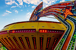 The ferris wheel and carousel rides spin into the night at The Blessed Sacrament Church Fiesta Fair in Westminster, CA. Byline, credit, TV usage, web usage or linkback must read SILVEXPHOTO.COM. Failure to byline correctly will incur double the agreed fee. Tel: +1 714 504 6870.