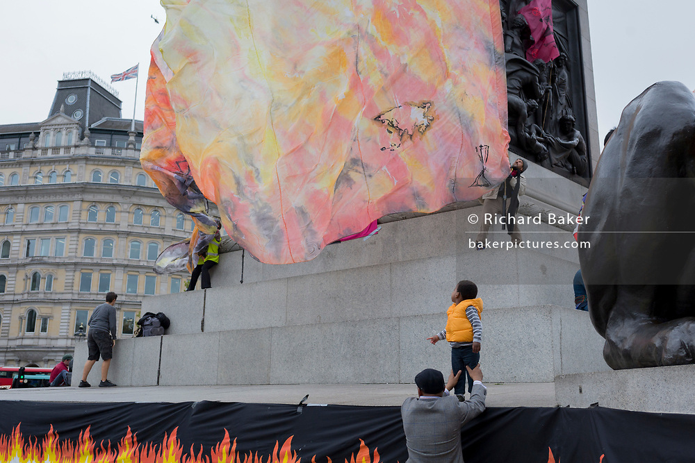 Environmental activists protest about Climate Change during an occupation of Trafalgar Square in central London, the first day of a two-week prolonged worldwide protest by members of Extinction Rebellion, on 7th October 2019, in London, England.