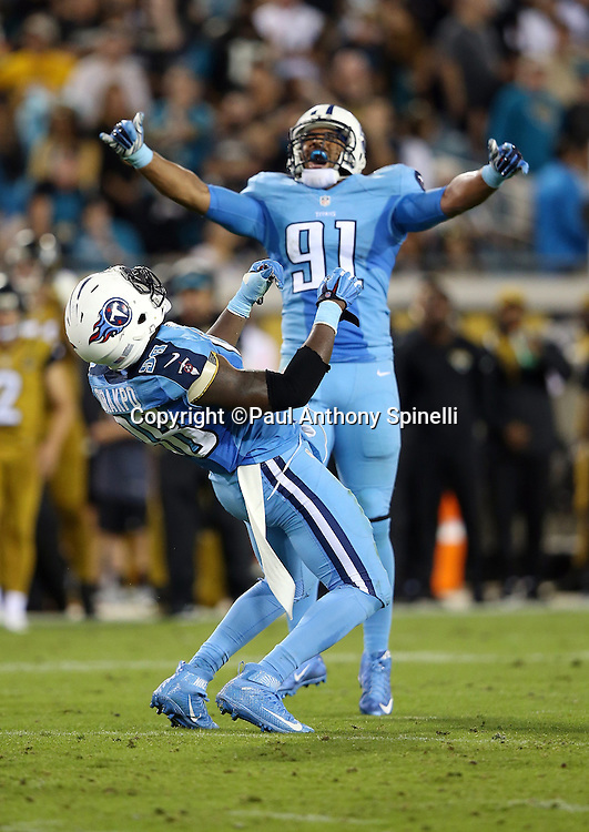 Tennessee Titans outside linebacker Derrick Morgan (91) waves his arms and celebrates while Tennessee Titans outside linebacker Brian Orakpo (98) celebrates wildly after sacking Jacksonville Jaguars quarterback Blake Bortles (5) late in the second quarter during the 2015 week 11 regular season NFL football game against the Jacksonville Jaguars on Thursday, Nov. 19, 2015 in Jacksonville, Fla. The Jaguars won the game 19-13. (©Paul Anthony Spinelli)
