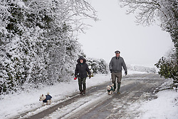 © Licensed to London News Pictures. 05/03/2016. Over Norton, Oxfordshire. Dog walkers at Over Norton. Snow in Oxfordshire early morning on 5th March 2016.. Photo credit : MARK HEMSWORTH/LNP